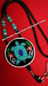 Kwek Peggy Kinder beaded pendant